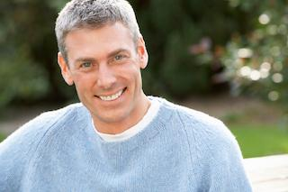 A man smiles outdoors | Cosmetic Dentistry Services in Columbia IL