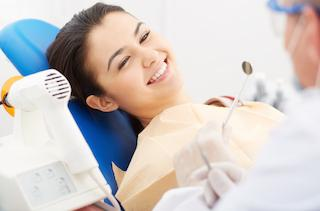 A woman smiles in the dental chair | Root Canal Treatment Columbia IL