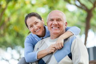 A couple smiles | Dental Implants Columbia IL