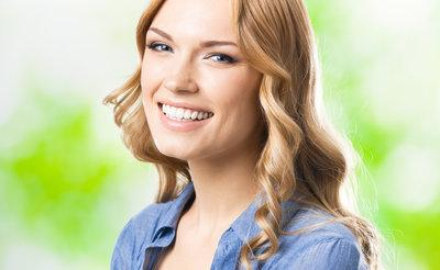 A woman smiles in | Cosmetic Dentistry Columbia IL