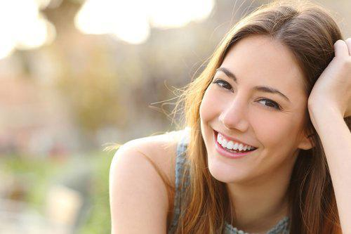 A woman smiles | Root Canals Columbia IL
