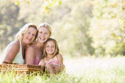 A family smiles in a meadow | Dental Bridges Columbia IL