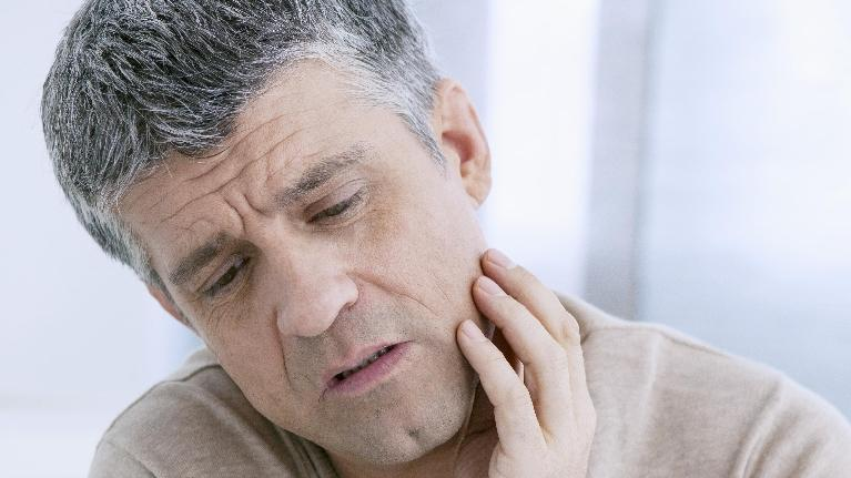 Man with Jaw Pain | Workman Family Dental